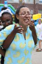 Kyla Grant (11) and Valonda Tyson (11) plays a sticky game with graham crackers, marshmallow puff, and Nutella. Photo by Julia Nguyen