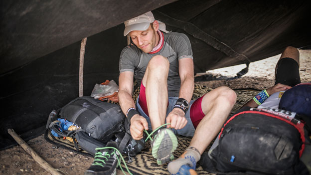 Marathon des Sables tying the inov-8 Race Ultra 270s