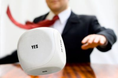 4000173 - businessman throwing the dice to make a decision