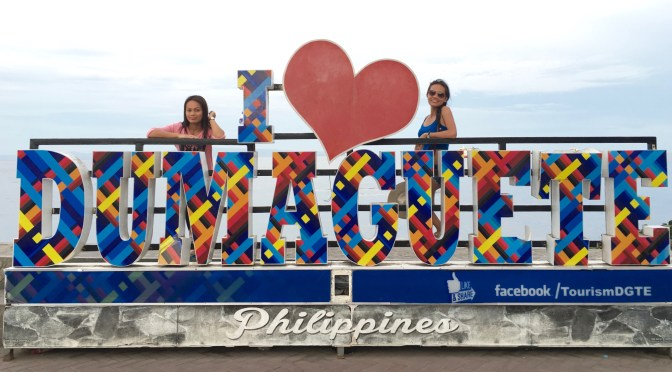 Janet and Jonna at the I love Dumaguete sign.