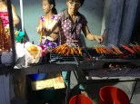 Grilling intestines on the streets of Puerto Pricessa.