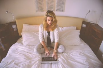 person-woman-hotel-laptop-large
