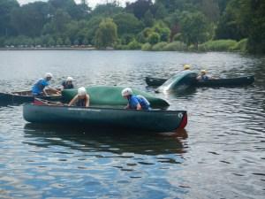 Emptying upturned canoes