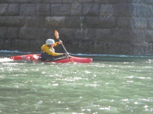 One of the students breaking into the flow under the Menai Bridge