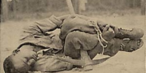 African American man tied to pickax