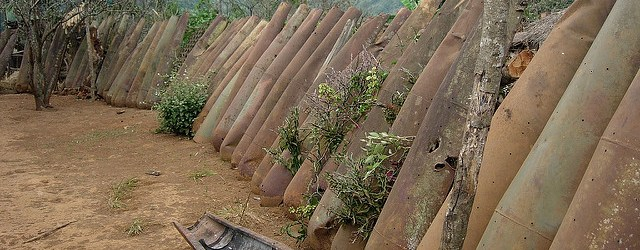 Bomb shells left over from the US secret bombing during the Vietnam War, lined up in a village outside Phonsavan. [Credit]