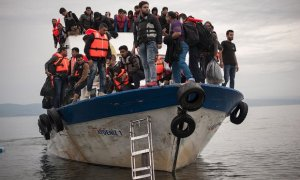 Refugees arrive from Turkey on the Greek island of Lesbos
