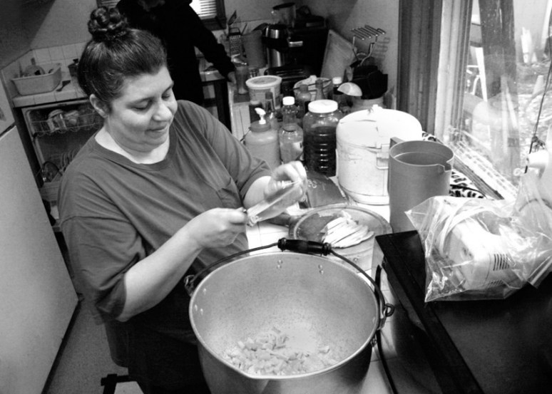 © Mary Anne Funk 2014 Diane Kimes of Anawim Christian Community, prepares a meal for the Anawim Community House meal and church service. Diane Kimes and her husband, Pastor Steve Kimes, have been serving the homeless community and the working poor community since the mid 1990's. Photo by Mary Anne Funk