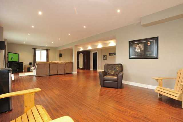 the bright walk out basement has a huge rec room with new quality