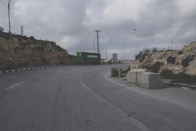 A checkpoint in the form of roadblocks on a road between Bethlehem and Hebron.