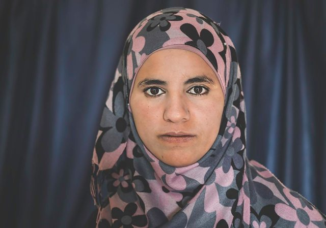 Amnah was 19 years old when she was forced to give birth to her first child at a military checkpoint. At 6 am, she woke up to birth pains and left the house with her mother for the hospital. Upon arriving at a checkpoint, they were held for five hours by Israeli soldiers. Amnah's mother tried to explain her daughter's situation as she was bleeding heavily, but they refused to let her through. By the time they were able to take another route to reach the hospital, the baby had died in her womb.