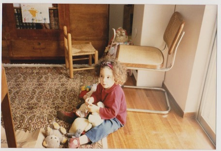 Me in my grandparents' house, playing with the toys we kept there. (Photo taken by someone in my family)