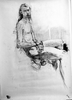 A charcoal life drawing of male model Andres, stitting side on, arms together