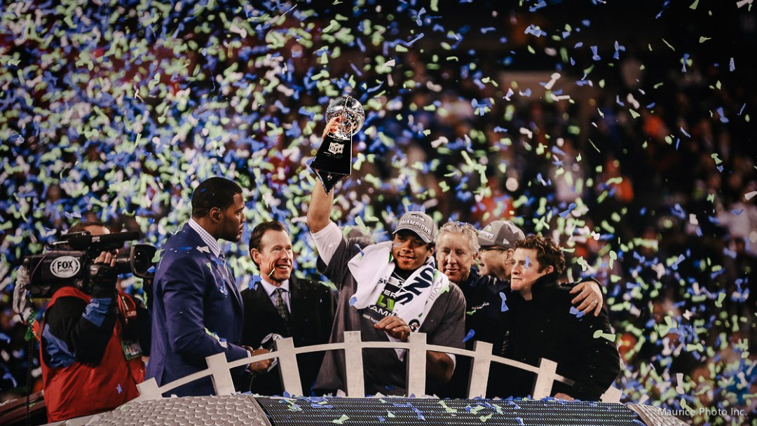 Russell Wilson holding Lombardi Trophy