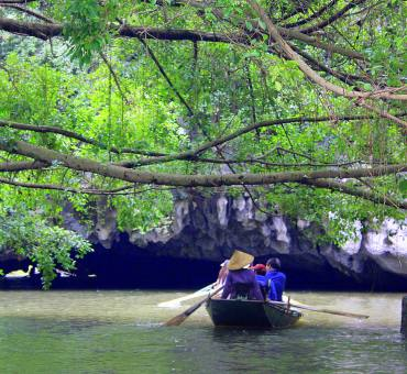Limestone karsts scenery of Tam Coc in Ninh Binh