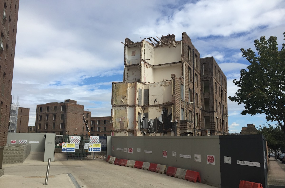 An existing block is demolished on the Peabody Estate in Clapham Junction to make way for new homes.