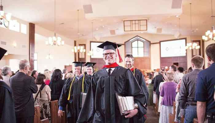 KANSAS CITY – Jonathan Johnston, with his master of divinity degree in hand, and other graduates celebrate during the recessional following Midwestern Seminary's commencement.  Midwestern Seminary photo by Liz Stack