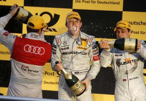 Di Resta celebrates after clinching the 2010 DTM title