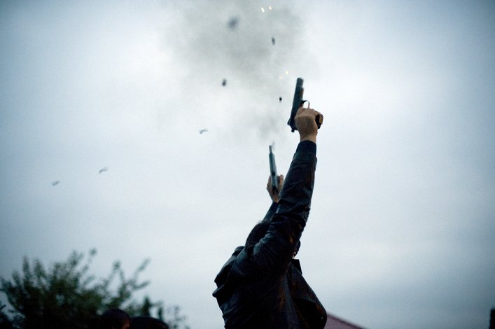 CAUCUSUS---SLUG: Ingushetia DATE: October 8, 2009  CREDIT: Andrea Bruce LOCATION: Ingushetia, russia CAPTION: Guns are shot in the air to celebrate the wedding party for Medina Khamkoyeva. The wedding took place   in a wealthy but traditional Ingushetia home.   Ingushetia is one of Russia's poorest and most restive regions. The ongoing military conflict in neighboring Chechnya has occasionally spilled into Ingushetia, and the republic has been destabilized by corruption and a number of high-profile crimes.   ( NOT FOR RESALE OR DISTRIBUTION--contact Andrea at andrea@andreabruce.com if there are inquiries)  StaffPhoto imported to Merlin on  Sun Oct 18 08:20:02 2009
