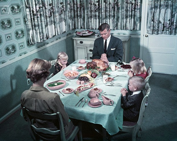 With every head bowed over the dinner table, a reverent family of five saying Grace, Thanksgiving Day, 1958.