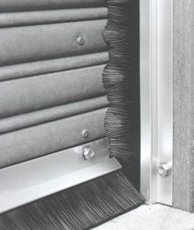 Brush door seals for rolling steel doors