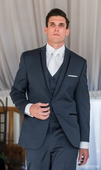 Three piece blue suit and white tie