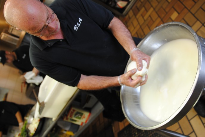 Bob Brannigan, owner of B&A Pork Store, making fresh mozzarella in his shop located in Dyker Heights, Brooklyn.