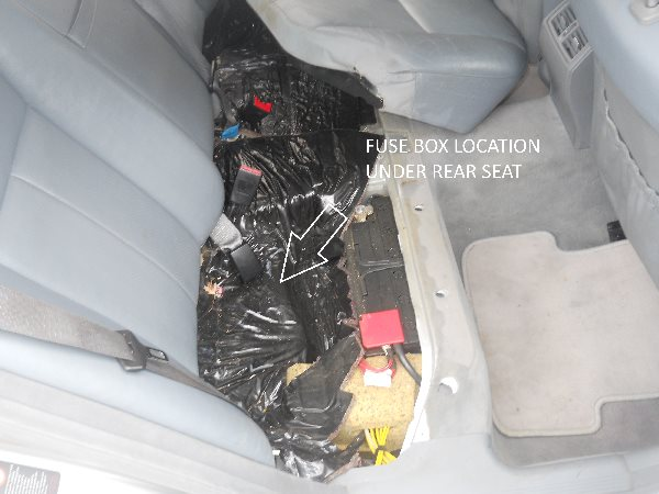 fuse panel in back seat of mercedes 430