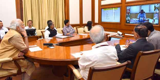 Prime Minister Narendra Modi taking a meeting through video conferencing.