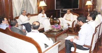 Rajnath Singh & M. Venkaiah Naidu with officials of home, law & justice ministries in New Delhi on March 29, 2016.