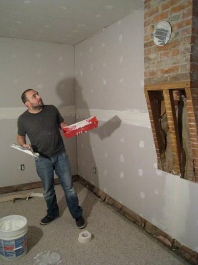 Taping and mudding post-drywalling.