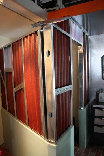 Corrugated panels block off filing shelving.