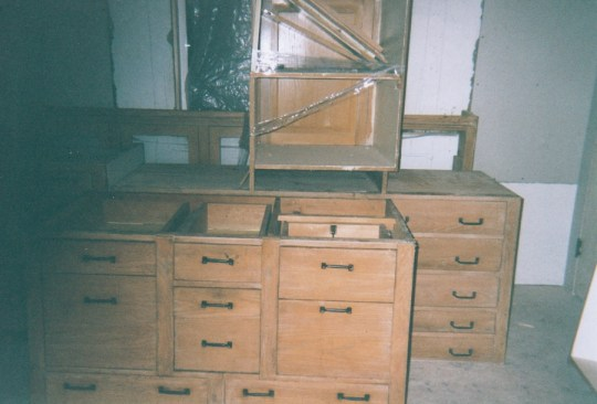 Before: Unfinished salvaged kitchen storage.