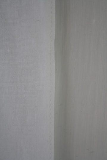 Hemmed curtain edge.