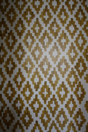 Perfectly imperfect hand-painted ikat wall paper.