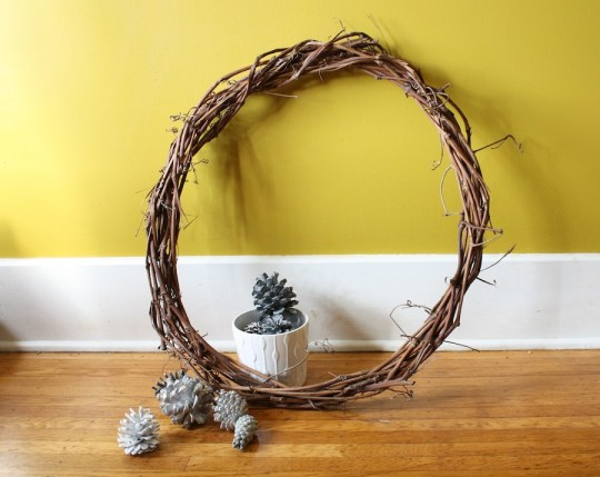 Painted pine cones and a handmade grape vine wreath.