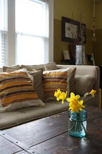 Updating the living room with new pillows (and daffodils).