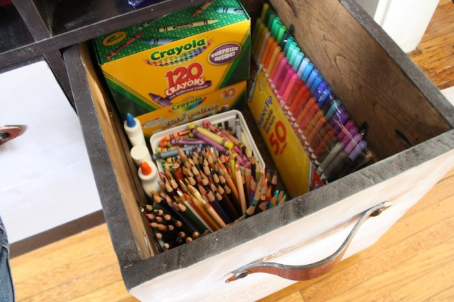 Starting to store away art supplies in our our new DIY boxes.
