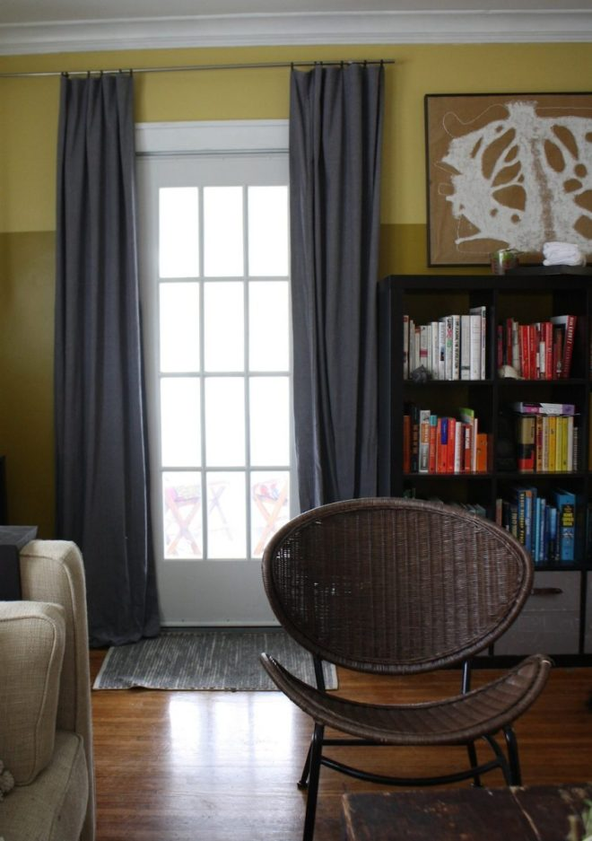 Toning down the living room with dark gray painter's cloth curtains.