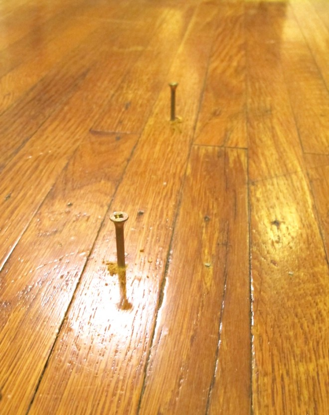 Squeaky floor correction using counter-sinking breakaway screws.