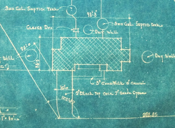Blueprints mapping the septic tanks in the yard.