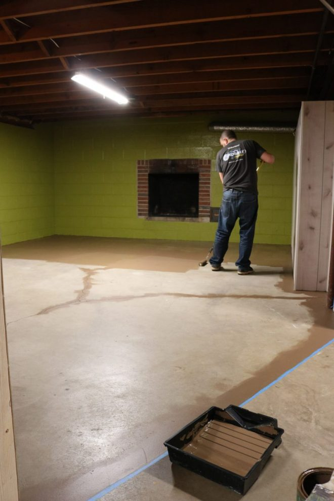 Cleaning and painting a basement cement floor.