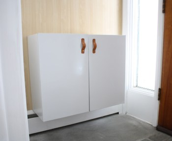 How to install a floating cabinet made from vintage metal kitchen cabinets.