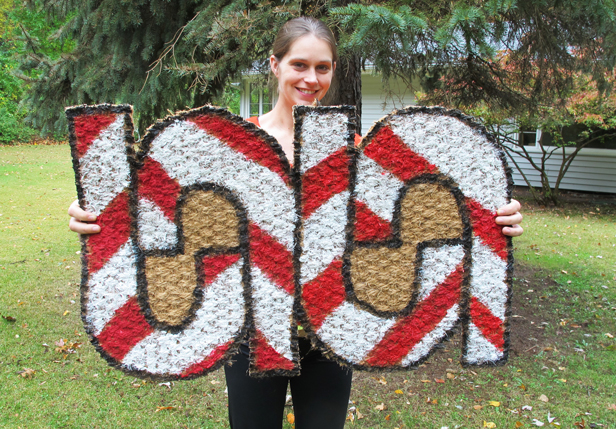 DIY holiday doormat with painted candy canes.