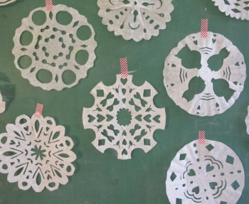 Making snowflakes out of coffee filters.