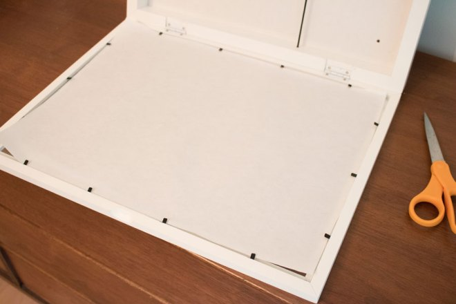Line the inside of the frame with a piece of paper to make a DIY lightbox.