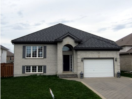 This Ontario home features Metal Roof Outlet's Steel Continental Tile in Weathered Wood style.