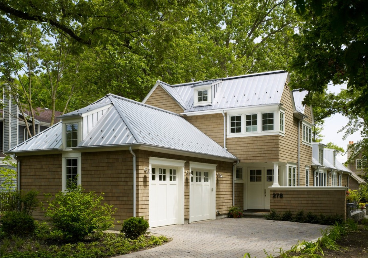 Metal shingles vs standing seam metal roof costs for Images of houses with metal roofs