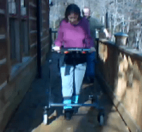Don't Look Back. Shelly now walks a mile three days a week using the gait trainer shown here.