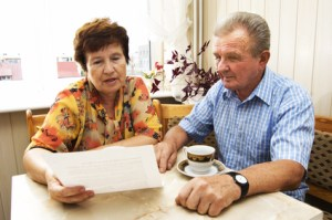 Senior couple studying Confusing Medical Bills